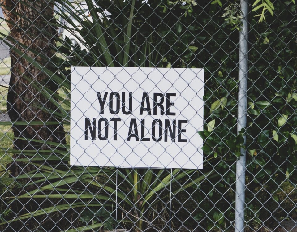 """sign reminding readers """"you are not alone"""""""